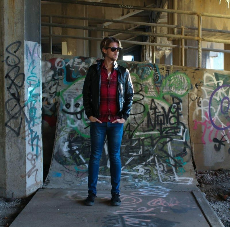 The Kentucky Gent in a Buffalo Plaid Shirt by JACHS, White V-Neck T-Shirt by BDG, Jeans by Topman, Black chucks by Converse.