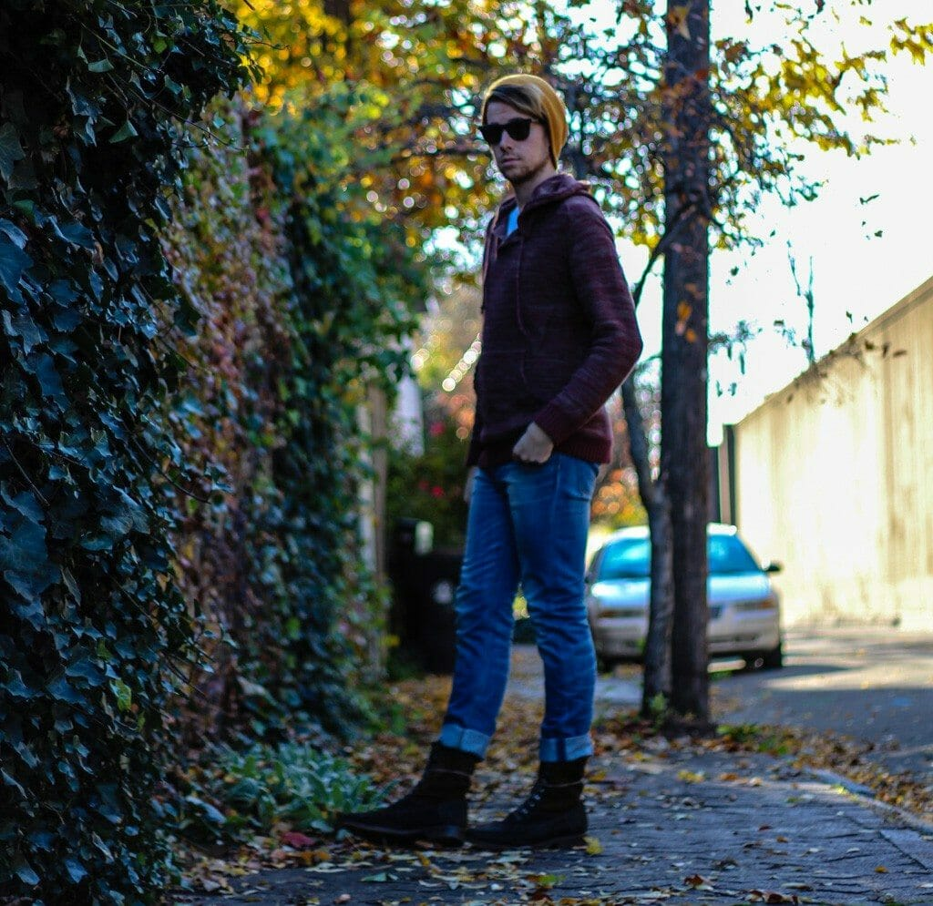 The Kentucky Gent in Comune Hansen Sweater, WESC Eddy Jeans, J Shoes Boots, Buffalo T-Shirt, 21Men Beanie, and Rayban Wayfarers