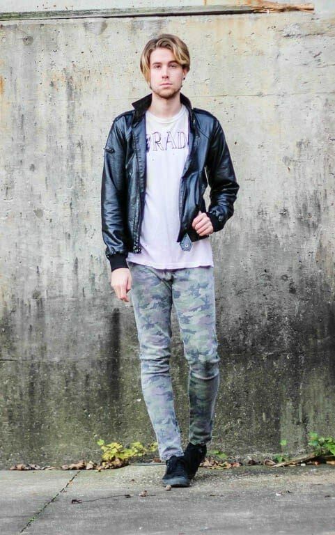 The Kentucky Gent in Rad T-Shirt by UNIF, Black Apple Leather Jacket, Tripp NYC Camo Rocker Pants, and Black Chucks by Converse