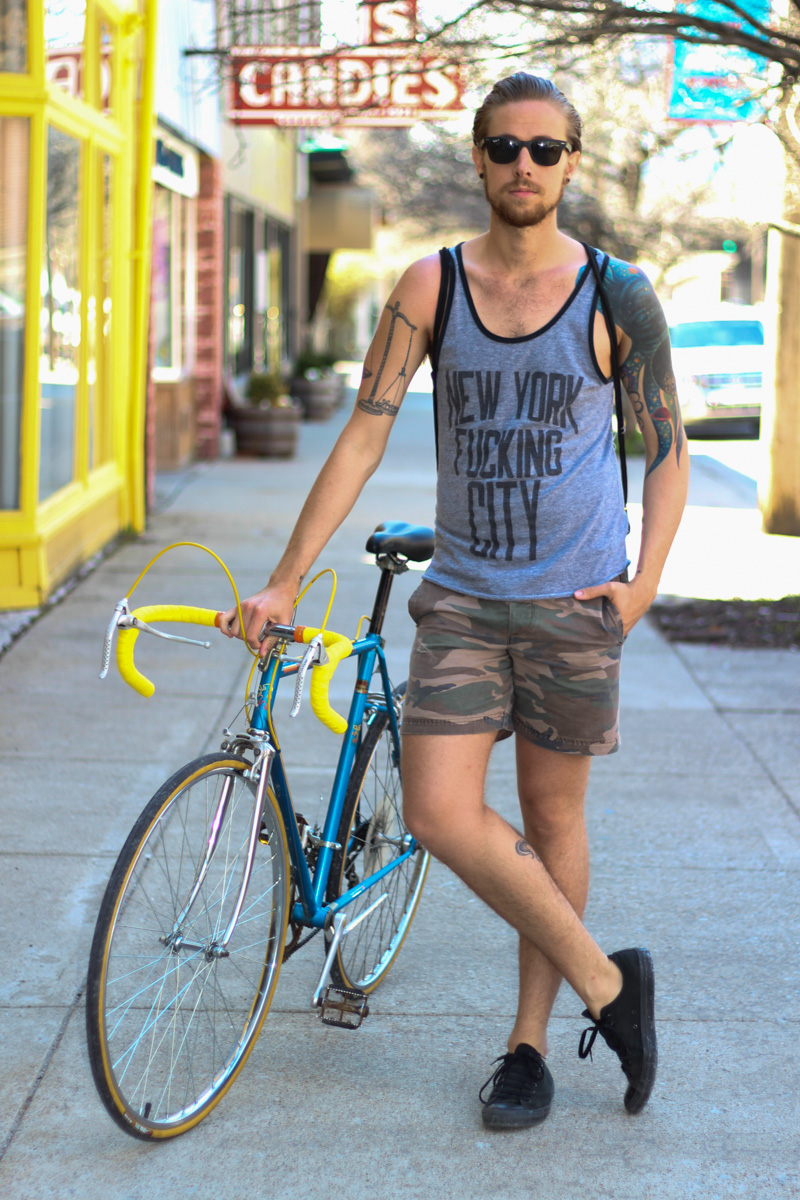The Kentucky Gent in Altru Tank Top, Topman Camo Shorts, Converse Chuck Taylors, Ray-Ban Wayfarers, Peugeot Bike