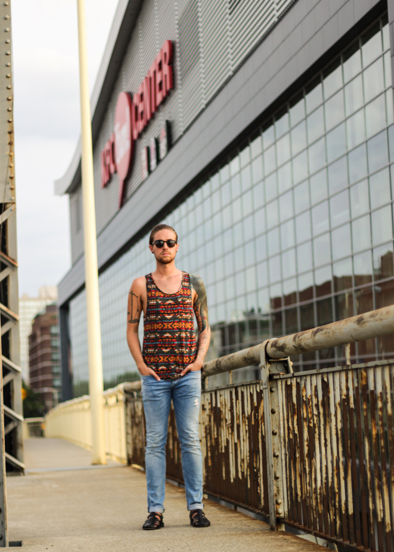 The Kentucky Gent in Original Penguin Briscoe Sunglasses, Obey Tank Top, H&M Light Washed Denim, and Zara Sandals.