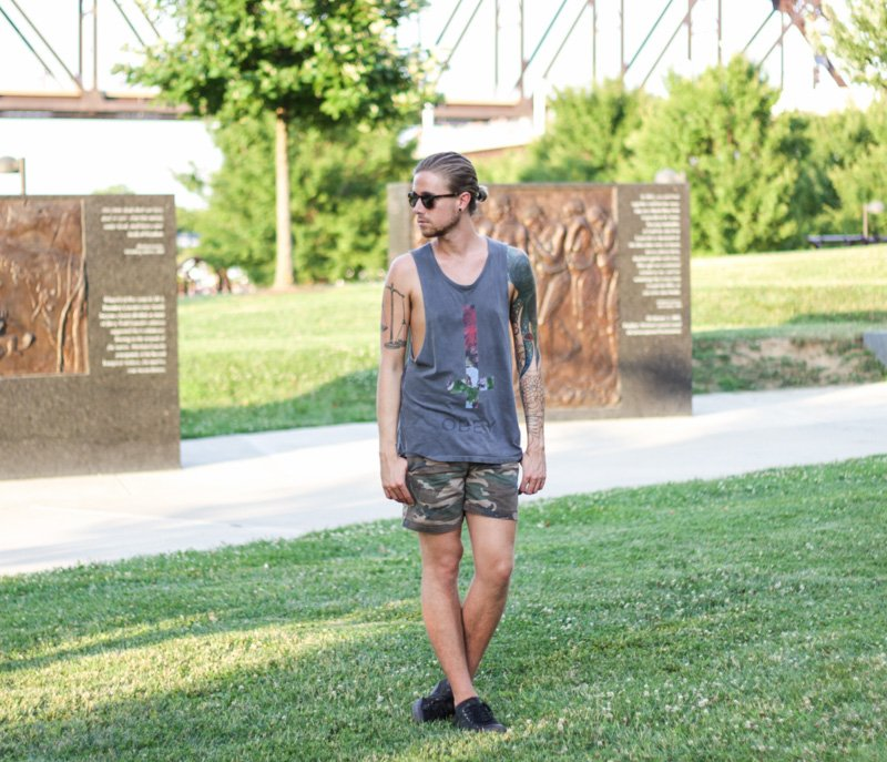 The Kentucky Gent in Original Penguin Briscoe Sunglasses, Obey Cut Off Tank Top, Topman Camo Shorts, and Converse Chuck Taylors.