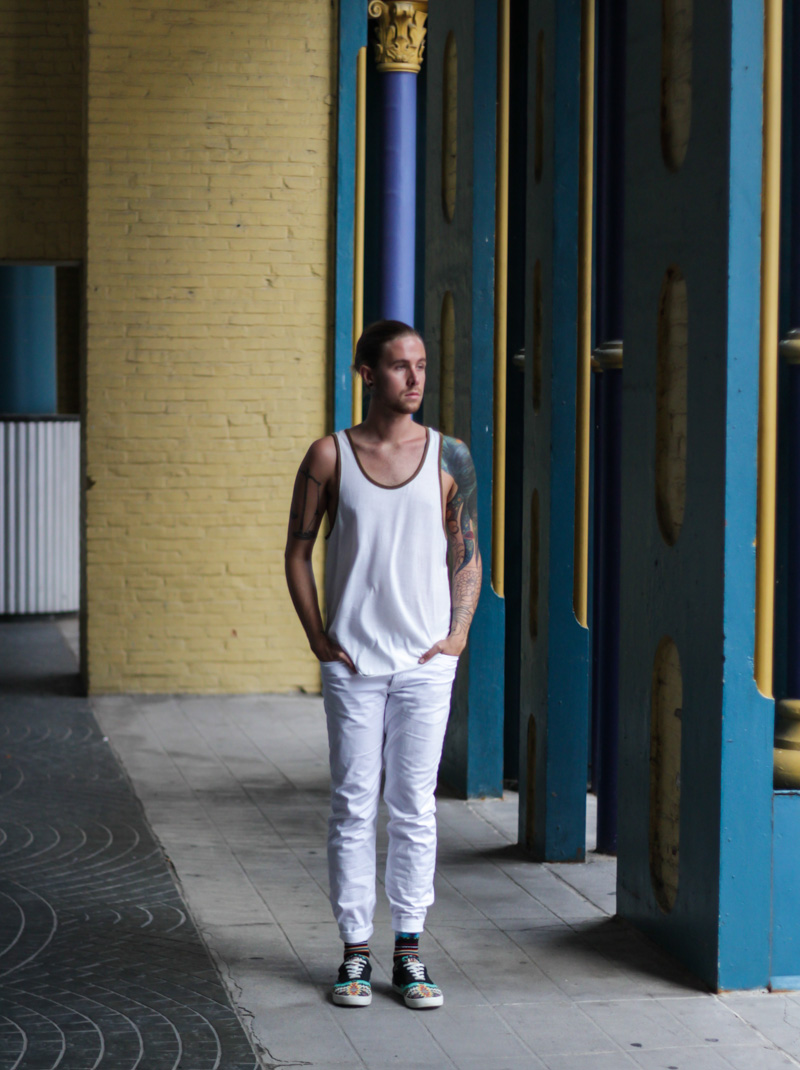 The Kentucky Gent in BDG Tank Top from Urban Outfitters, H&M White Twill Pants, Richer Poorer Socks, and Bucket Feet Shoes.