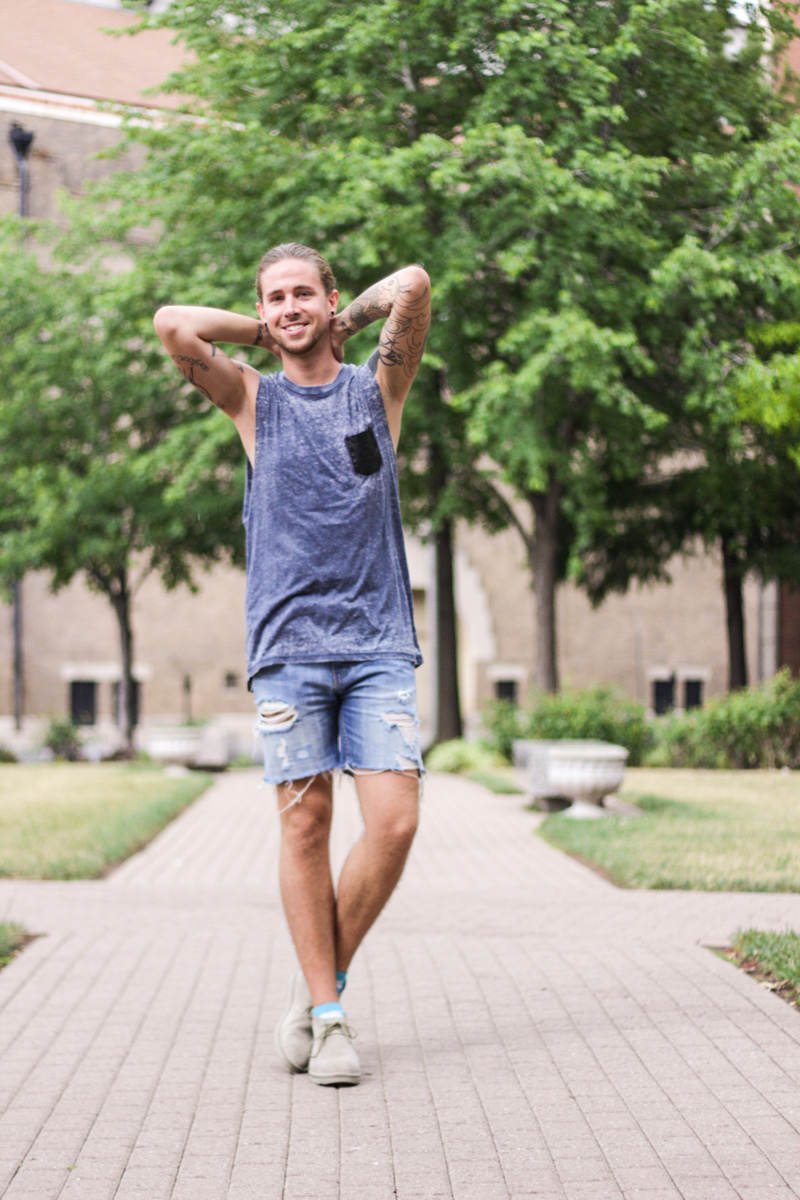 The Kentucky Gent in The Narrows Leather Pocket Tank Top, Levi's Cut Off Shorts, Richer Poorer Paradise Socks, and CAT Footwear Suede Chukka Boots.