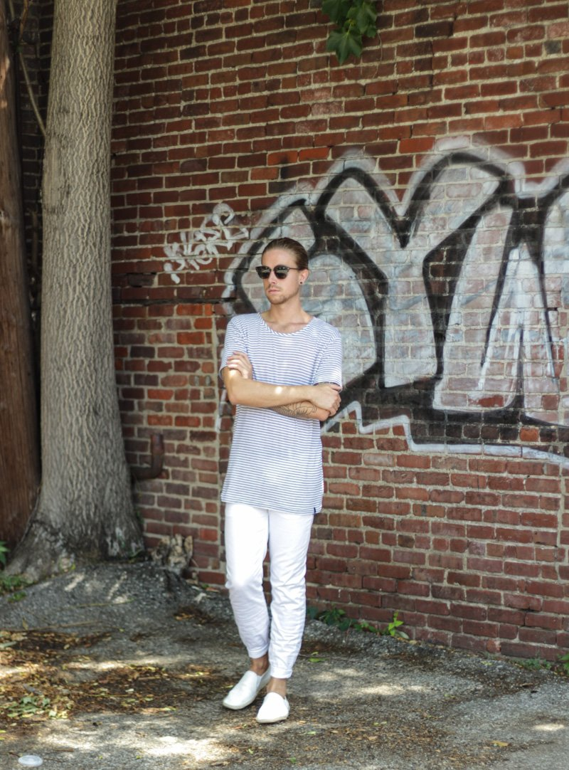 The Kentucky Gent in Spy Optic Sunglasses, Copy Collection Oversized Striped T-Shirt, H&M White Linen Pants, and H&M White Espadrilles.