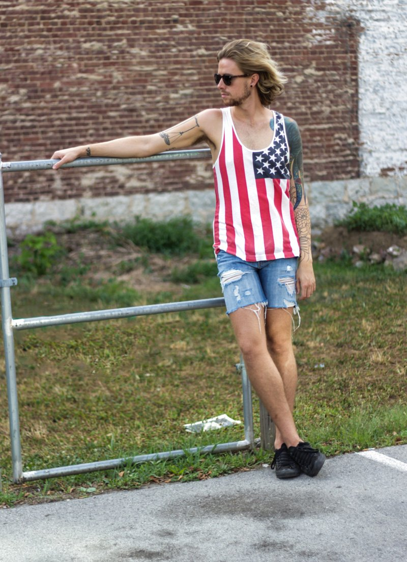 The Kentucky Gent in American Flag Tank Top, Levi's 508 Cut Off Shorts, Converse Chuck Taylors, and Original Penguin Briscoe Sunglasses.