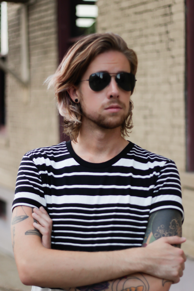 The Kentucky Gent, a men's fashion and life style blogger, in BDG Striped T-Shirt, Levi's 511 Jeans, Dr. Martens Combat Boots, and Ray-Ban Aviator Sunglasses.