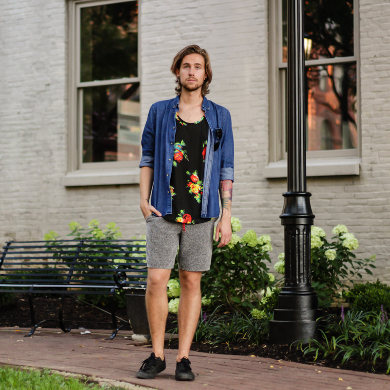 The Kentucky Gent, a men's southern life and style blogger, in H&M Denim Shirt, BDG Floral Tank Top, Urban Outfitters Sweatpant Shorts, Ray-Ban Aviator Sunglasses from East Dane, and Converse Chuck Taylors.