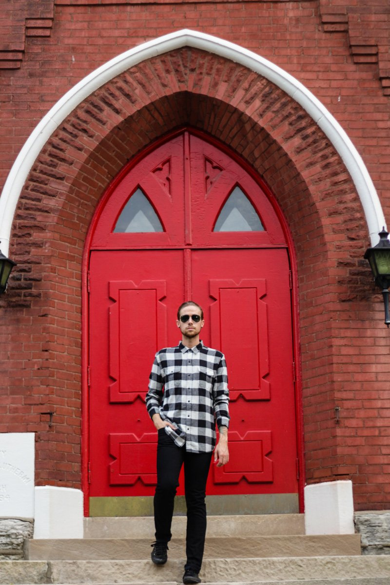 The Kentucky Gent, a men's life and style blogger, in Salt Valley Plaid Shirt, Ray-Ban Aviator Sunglasses from East Dane, Levi's 511 Skinny Jeans, and Converse Chuck Taylors.