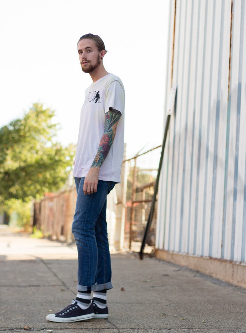 The Kentucky Gent, a men's fashion and life style blogger, in UNIF T-Shirt, Levi's 511 Jeans, Converse Chuck Taylors, and Richer Poorer Socks.