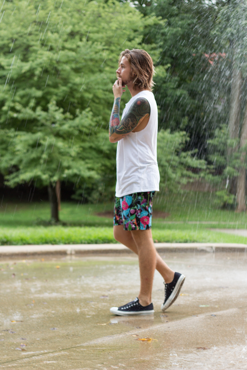 The Kentucky Gent, a men's fashion and life style blogger, in Topman Muscle Shirt, Ambig Floral Shorts, and Converse Chuck Taylors.
