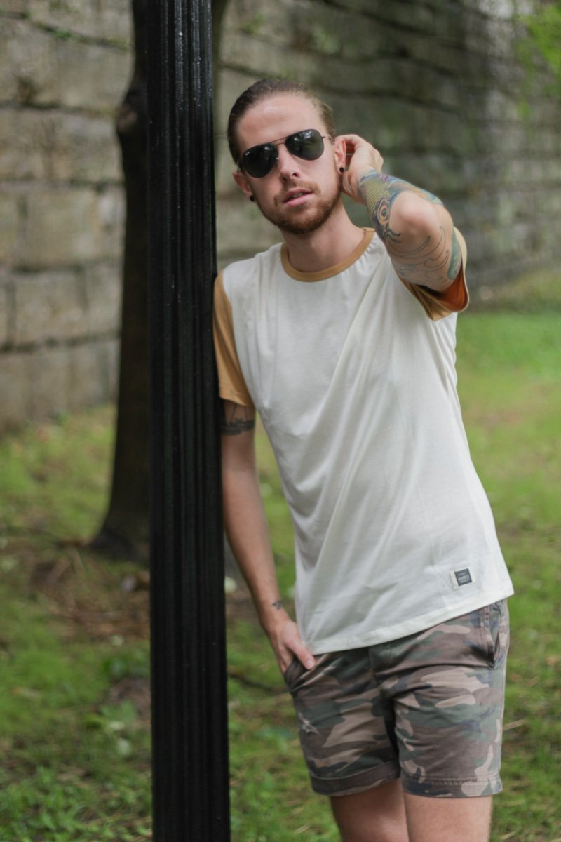 The Kentucky Gent, a men's fashion and life style blogger, in Ambig Clothing T-Shirt, Topman Camo Shorts, Converse Chuck Taylors, and Ray-Ban Aviator Sunglasses.