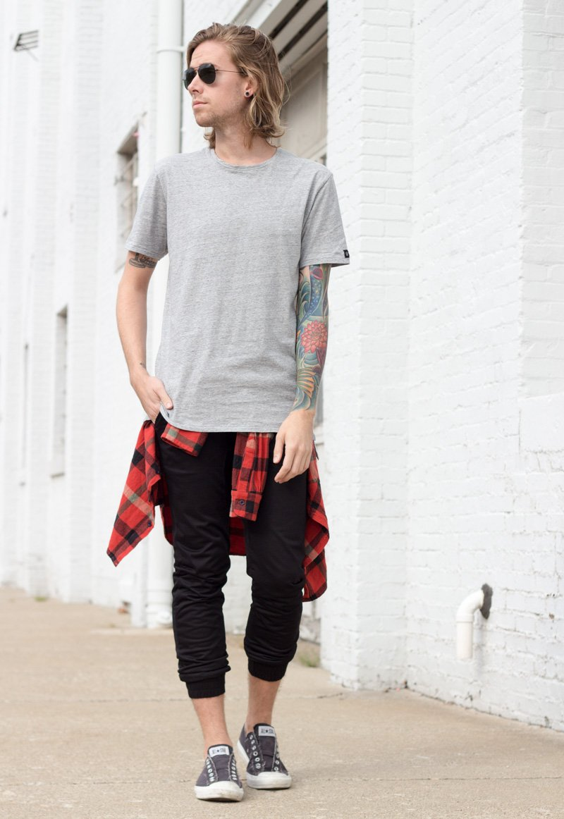 The Kentucky Gent, a men's fashion and lifestyle blogger, in Zanerobe T-Shirt, UNIF Plaid Shirt, Zanerobe Mesh Joggers, Converse Chuck Taylors, and Ray-Ban Aviator Sunglasses.