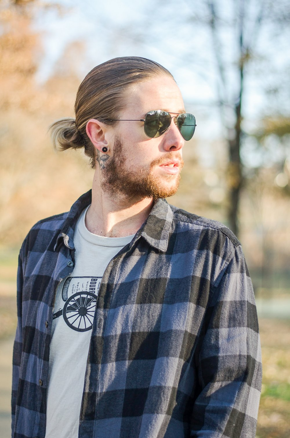 The Kentucky Gent, a Louisville, Kentucky life and style blogger, in Y'allsome Kentucky Bourbon Tee, H&M Plaid Shirt, Levi's Made & Crafted Denim Pants, Richer Poorer Socks, Volley High Top Sneakers, and Ray-Ban Aviator Sunglasses.
