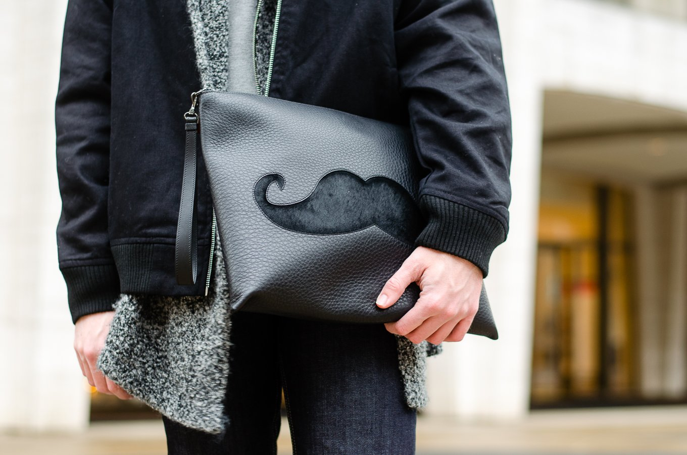 The Kentucky Gent, a men's fashion and lifestyle blogger, spends his first day of NYFW at Lincoln Center in Christian Louboutin sneakers and bag.