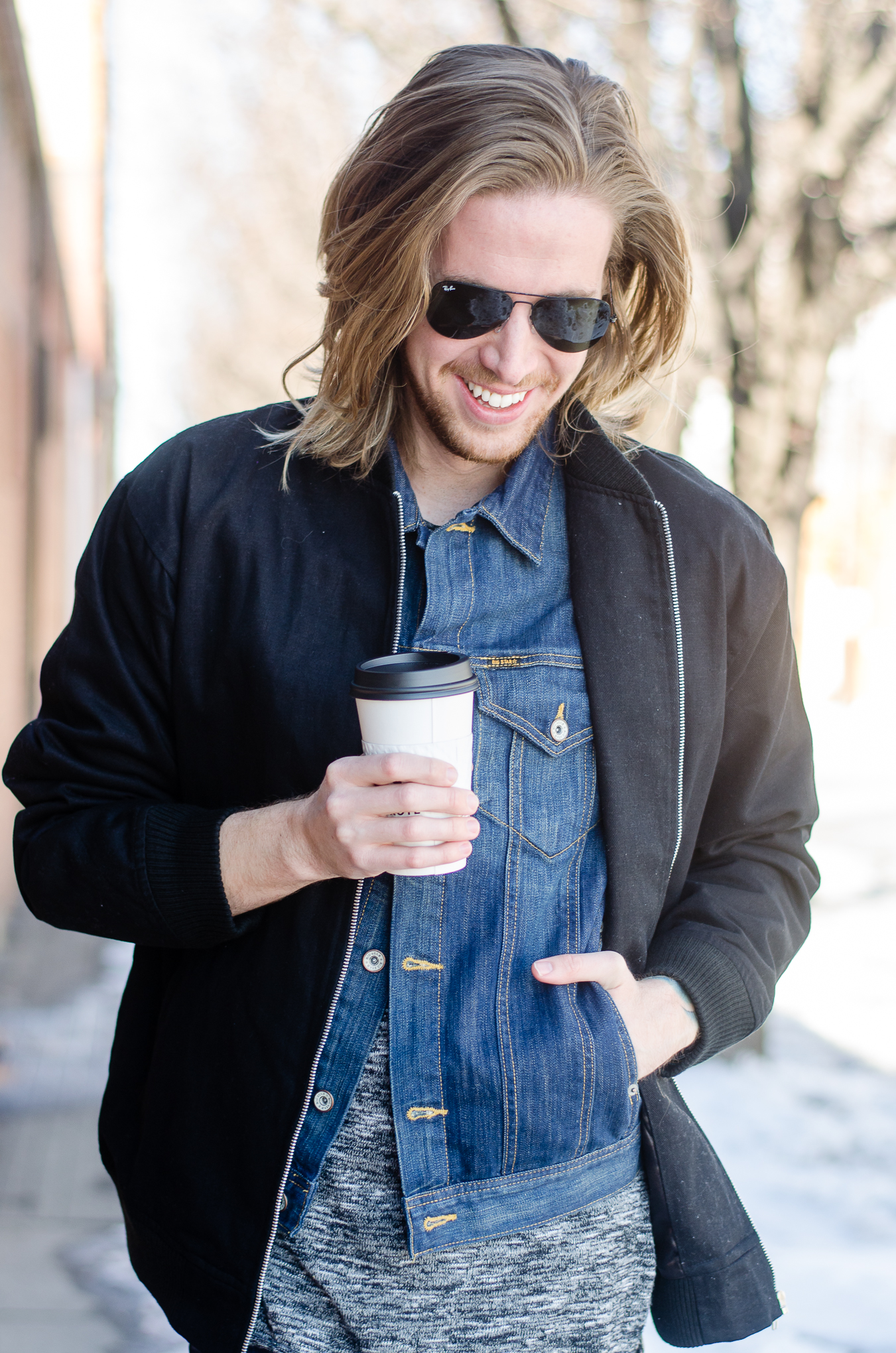 The Kentucky Gent, a men's fashion and lifestyle blogger, whips his hair back and forth.