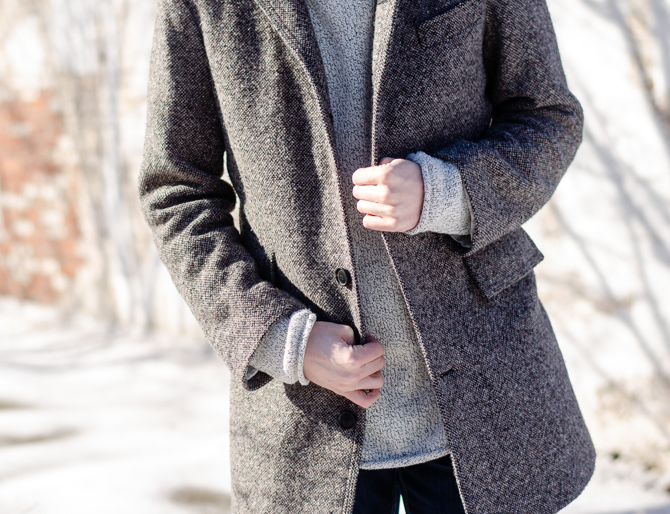 The Kentucky Gent, a men's fashion and lifestyle blogger, doubles up in  an H&M sweater and Billy Reid coat.