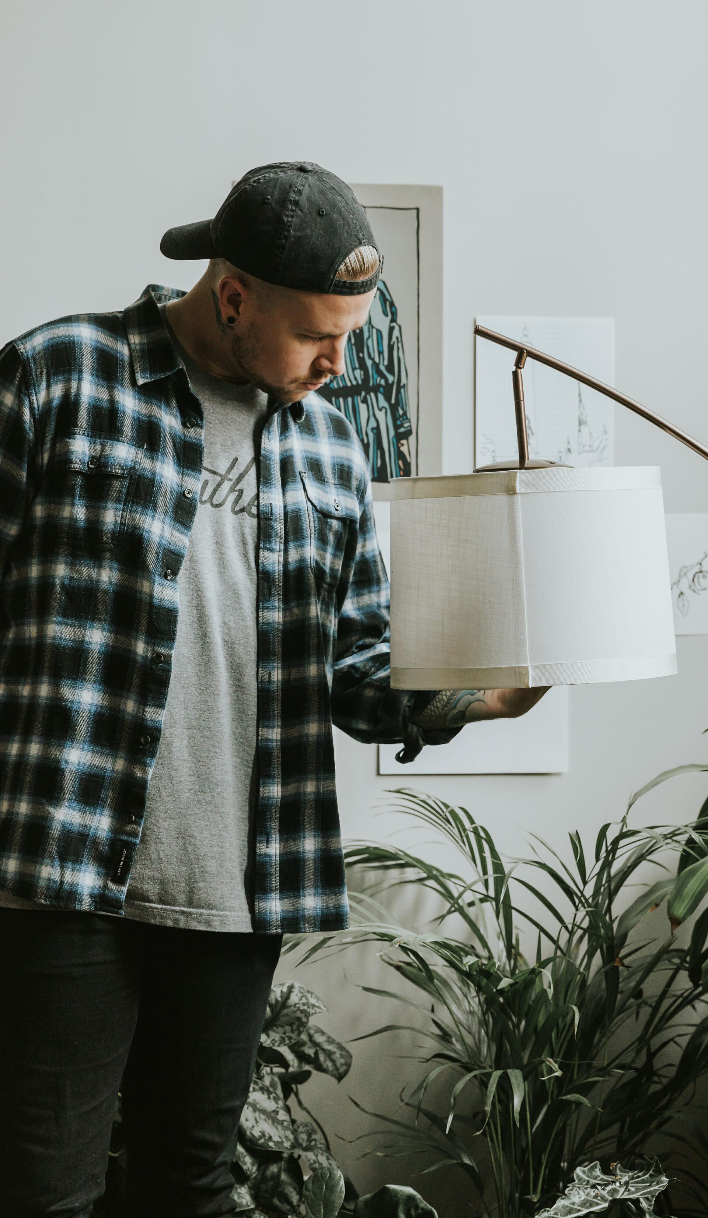guy screwing in light bulb
