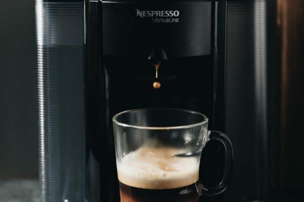 nespresso machine brewing coffee