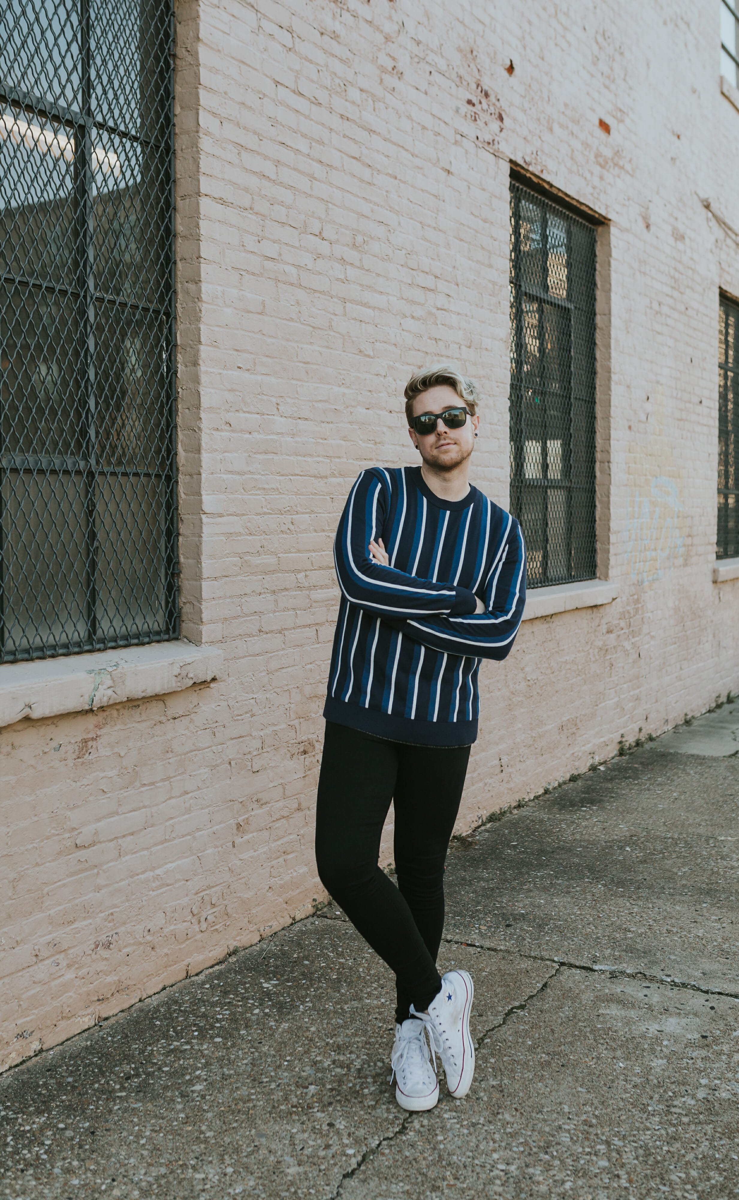 man wearing blue and white striped sweater