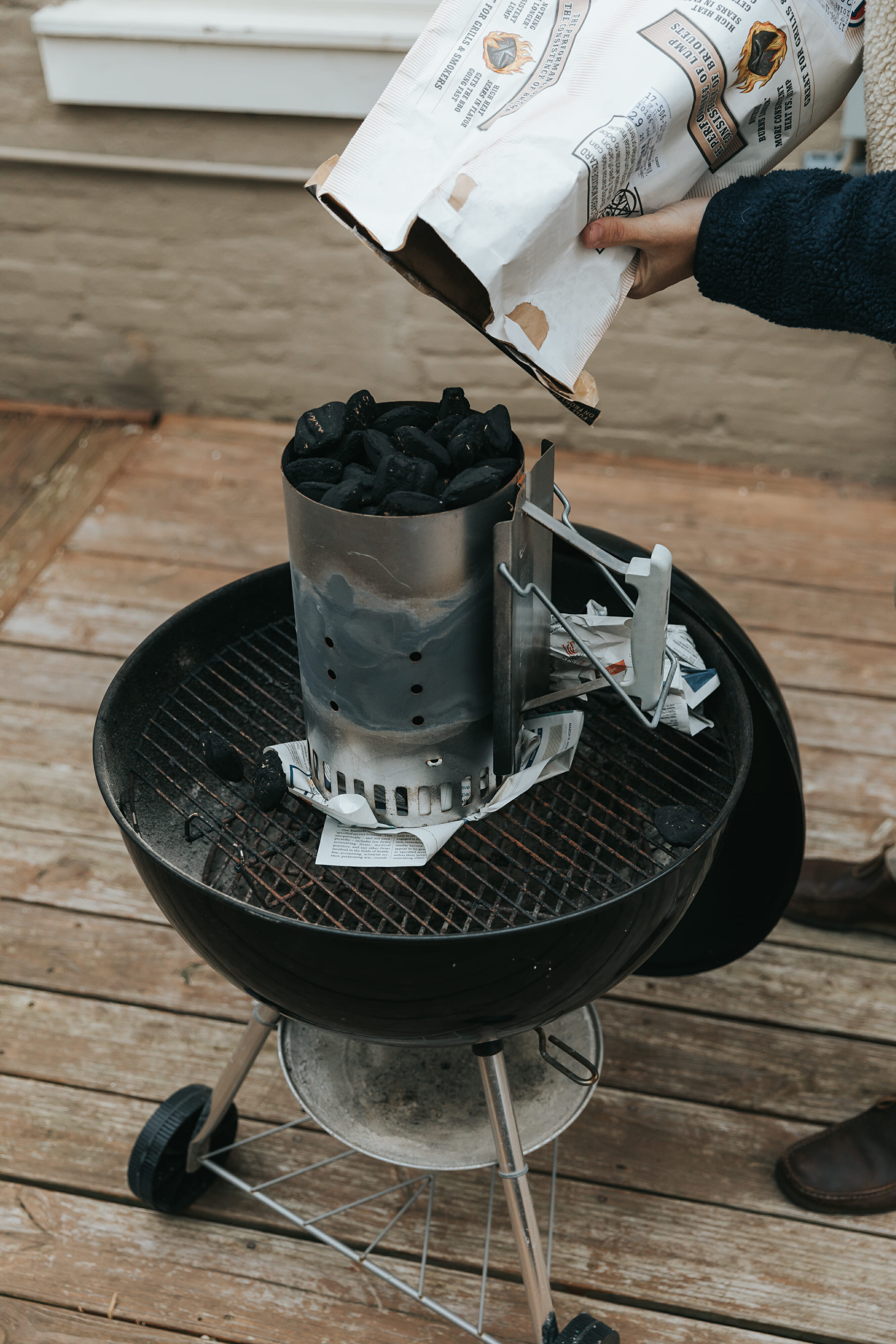 man preparing grill