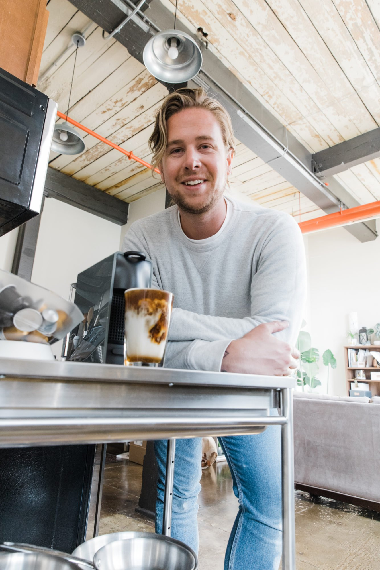 man with nespresso machine