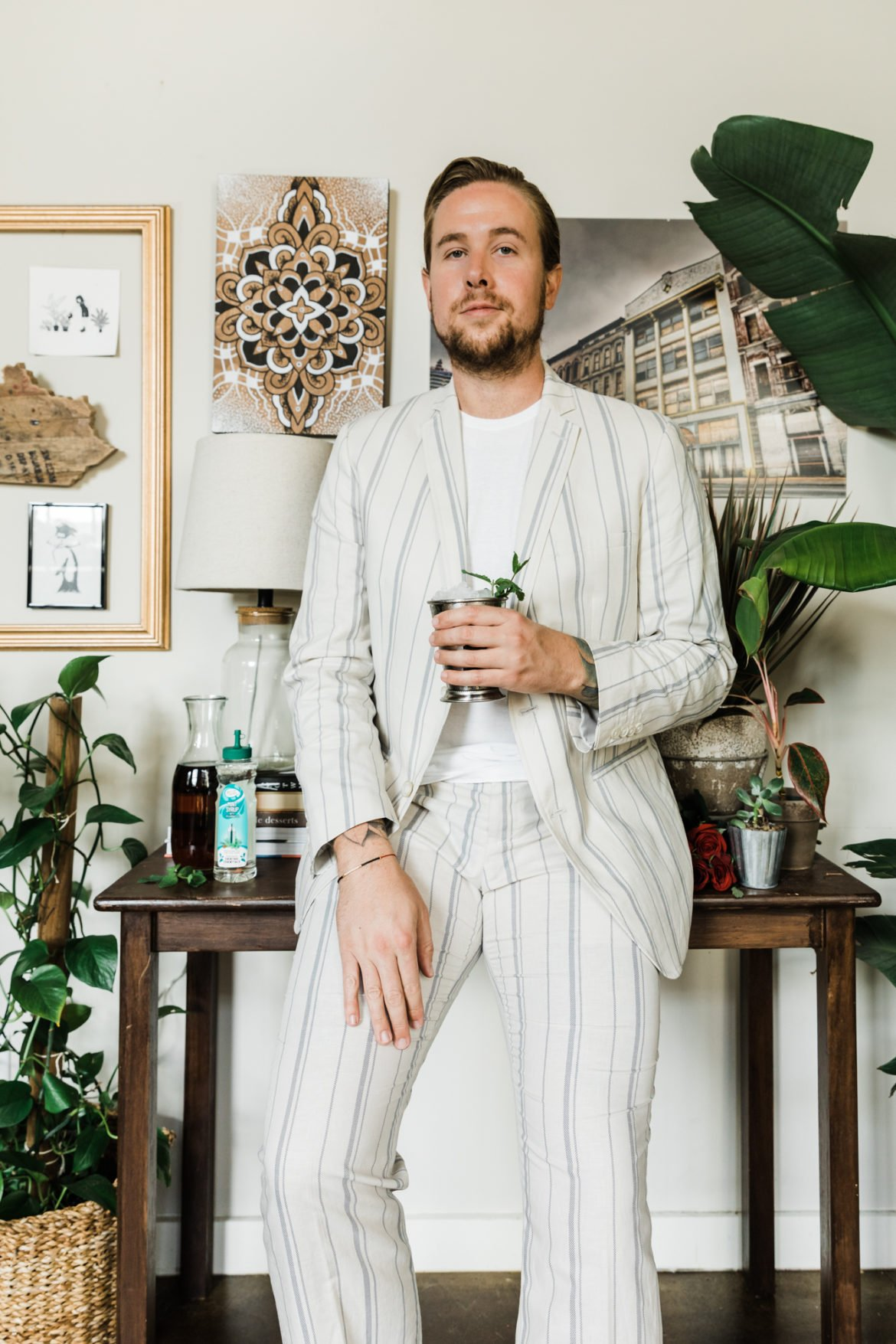 man in white suit with mint julep