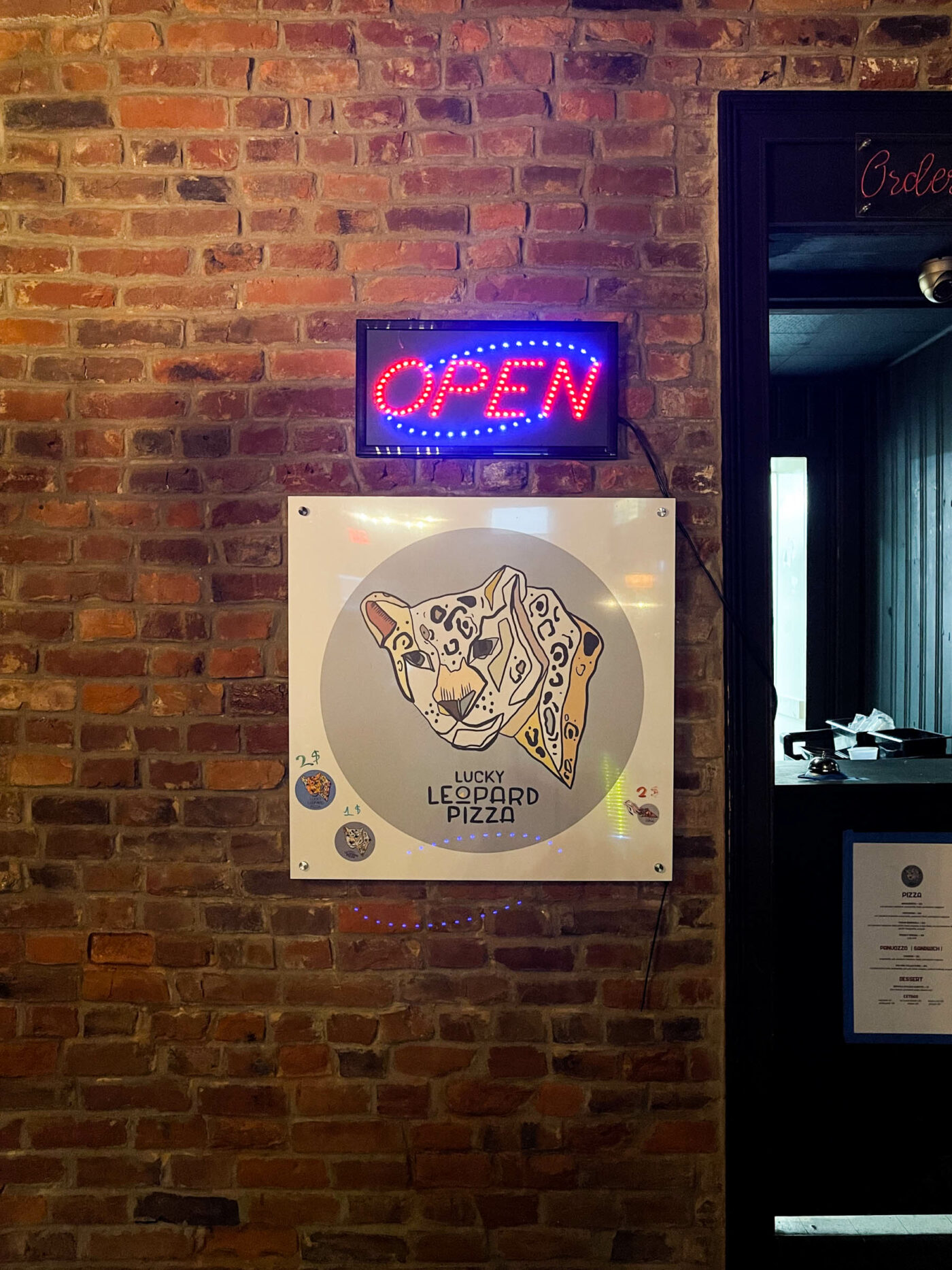 lucky leopard pizza sign